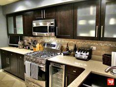 I like the light granite with dark cabinets.