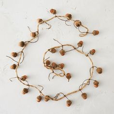 "Strung with carved, wooden acorns, this garland adds a woodsy touch at home during the cooler months.- Wood, hemp- Indoor use only- Imported55""L"
