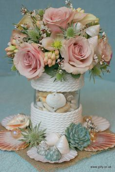 Sea shell floral wedding table centres - g lily