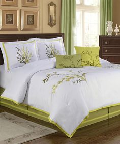 natures way comforter set. the colors are striking and it pairs well with dark wood furniture.