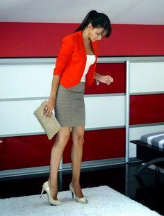 Orange blazer with beige skirt                                                                                                                                                     More