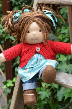This is Grace.  She has sunkissed skin and brown eyes. Her hair is made with various wool and mohair yarns with a hand dyed fairy bit throughout. Grace comes with the pictured outfit, underpants and wool felt shoes.