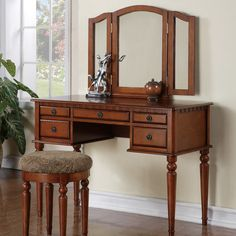 Features:  -Simple yet sophisticated.  -Drawers are removable and replaceable.  -Removable knobs.  Product Type: -Vanity set.  Style (Old): -Traditional.  Mirror: -Yes.  Drawers Included: -Yes.  Mirro