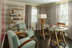 A glamorous office space by Kristin Paton Interiors, with a Brass and Glass Trestle Desk and Art Deco Arm Chairs.