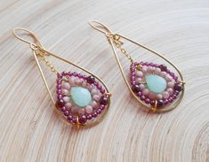 Freesia gemstone beaded hoop earrings charm with their unique design and the lovely soft colors of the gemstones. I wire wrapped with gold filled wire a lovely light green faceted drop briolette and surrounded it with blush pink blush pink rhodochrosite faceted beads and garnet