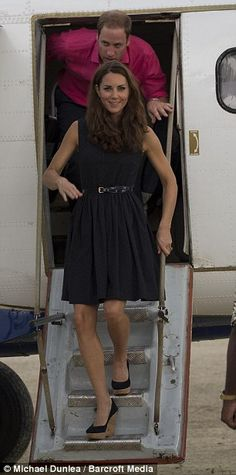 Royal entrance: Kate steps off the plane for the next leg of her and William's South Pacific tour