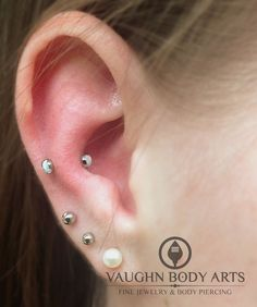 2 1/2 year old healed snug piercing on our awesome client Jessica. She stopped in for a snugger fitting curved barbell and picked out t...