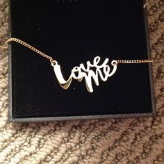 Love me necklace Limited quantities made by Victoria secret it is gold plated the picture makes it look silver it is not Victoria's Secret Jewelry Necklaces