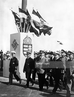 German Führer Adolf Hitler accompanied by Admiral Miklos Horthy, regent of the Kingdom of Hungary, stand upon the harbor of Kiel to view the official launch ceremony of the new battle cruiser 'Prinz Eugen'. The Hungarian leader's visit to the Reich included many displays of the new Germany, including grandiose military parades, civil celebrations, and airshows by the Luftwaffe. German Reich, August 22nd, 1938. Prinz Eugen, War Dogs, The Third Reich, Poster Pictures, Luftwaffe, Battleship, Titanic, World War Two, Hungary