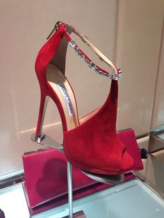 A lady will always look perfectly stylish, when wearing Jimmy Choo. Love the red!