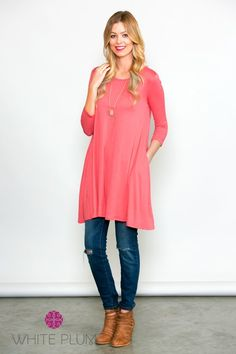 "Spruce up your Spring wardrobe with the Perfect Pocket Tunic from White Plum! This plush piece is designed with 3/4 sleeves, a rounded neckline, side pockets and a longer hemline so you can pair with leggings or jeans. Complete this look with a long necklace and you're ready to Spring into the season in style!COLORS AVAILABLE BlackMintCoralTurquioseLavenderNavyWOMEN'S SIZING Small (0-4)Medium (6-8)Large (10-12)Models are 5'6"" and 5'9"" - wearing size smallMeasures approximately 38"" in length…"