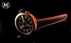 Black dial with orange case ring. Pre-order now at marchandwatches.com