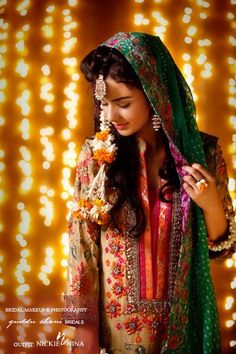 Indian bride wearing bridal salwar. Mehndi and sangeet look