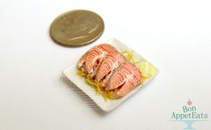 1:12 Dollhouse Scale raw salmon steaks made from polymer clay.