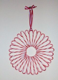 Candy cane wreath....this would be so cute to take to work/school and just let people take a candy cane when they want.