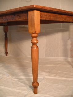 A grainery board table with turned legs.
