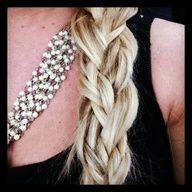 """1. Separate hair into 3 sections, per usual with a braid.  2. Braid 2 of your 3 sections into small braids and leave your third section as is.  3. Braid the 2 braids and the section you left out together loosely and secure with a hair tie.  4. Once secured in a hair tie, loosen your braid to make it look fat by gently pulling on each side of your braid and mushing it up."""" data-componentType=""""MODAL"""