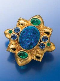 Lapidary Journal Jewelry Artist, July 2013. Featured on the Cover: Lightning Ridge opal pin/pendant with emerald, blue sapphire, 18K gold, by Paula Crevoshay. PHOTO: JIM LAWSON