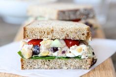"""Smashed chickpea Greek salad sandwich from Two Peas and Their Pod - Eat Your Books is an indexing website that helps you find & organize your recipes. Click the """"View Complete Recipe"""" link for the original recipe."""