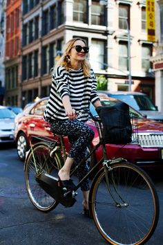 the-sartorialist-girl-bike-soho-leopard-bicycle-stripes