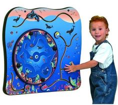 Let their imaginations soar as the ocean gets bigger while they play with the Whale of a Time Wall Toy. Kids navigate the inner maze and move colorful creatures around the surrounding seascape on this beautiful commercial quality toy. Perfect for high traffic areas like malls, museums, pediatric hospitals and other places where children come to play or wait. #playscape #sensoryedge #walltoy http://www.sensoryedge.com/whale-of-a-time-wall-toy.html