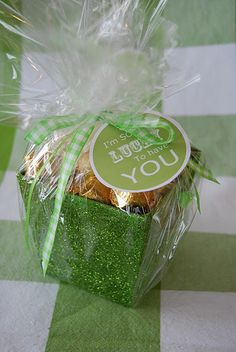 Tissue paper  Rolo Candy  Green Sparkle box...Found @  Target of course :)  Cellophane  Ribbon