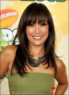 long layered hair with long side bangs | Carrie Ann Inaba Layered Hairstyle with Bangs
