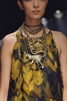 Lanvin at Paris Spring 2015 - living the brass accessories, particularly the brass monkey balancing on the chains