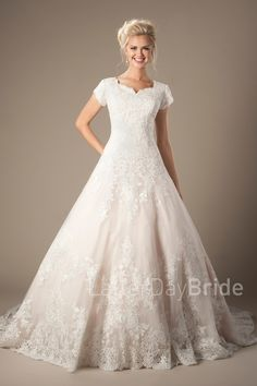 Dennison | Modest Wedding Dress | LatterDayBride | Worldwide Shipping | This lovely A-line ball gown features a full lace pattern, scalloped neckline and flattering waistline.    Gown available in White, Ivory or Champagne/Ivory     *Gown pictured in Champagne/Ivory, with and without an additional petticoat