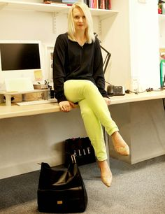 ELLE Editor in Chief Lorraine Candy works the neon trend for spring summer 12 in J Brand at Donna Ida jeans styled with a Uniqlo jumper, Office shoes, a Smythson Emily Hobo bag and a Dolce & Gabbana necklace.