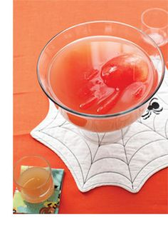 There are only three steps between you and a successful Halloween party punch:       1. Get the orangey hue by mixing 2 cups pineapple juice with 1 cup cranberry juice and 1 cup seltzer.     2. Add a spooky floating hand by filling a rubber glove with water (you can dye the water with natural food coloring first, if you'd like), knotting the wrist, freezing for 24 hours, then cutting the glove off and rinsing the hand under cold water.     3. Place the hand in the punch bowl and wait for…