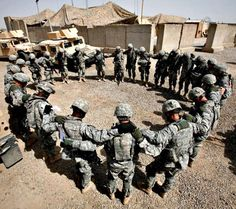 Soldiers gathered in prayer