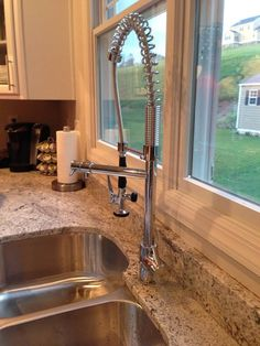 Just installed this Kraus Faucet with my new granite.  It's got a separate spout just for water, and then one that serves as pot filler/sprayer.  So sturdy - I LOVE it!