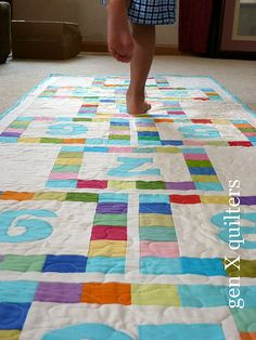 What a fun idea for a kid's quilt. Maybe fun things like roads, candyland, etc too!