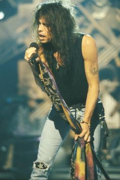 Steven Tyler. Rock and Roll. One of the few rock singers and music I kike. G-
