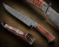 """Maker: Mike Quesenberry, MS  Integral Damascus Fighter Fully forged double guard and bolster with a tapered tang. Stacked W pattern Damascus from 1080 and 15n20. Sculpted Koa scales left proud of the damascus. Domed Argentium Silver pins. Swept clip (sharp). Parkerized finish. Blade Length: 8 3/4"""" Overall Length: 14"""""""