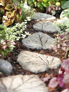(1) map out a path of steps matching your stride & carve a leaf shape hole about 3 in deep (2) lay a 1 in base of pea gravel & coarse sand (3) add water to half a bag of quick-setting concrete mix blend until it's thoroughly moist (4) fill the hole evenly w/ concrete press & sculpt it into leaf shape (5) place a leaf vein-side down & press firmly to make detailed impression (6) cover the stepping-stone w/ damp burlap to help strengthen the concrete for a week.