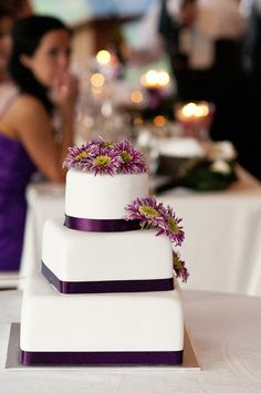Classic purple and white wedding cake by Sweet Thea Cakes. Photography courtesy of Cecilia Flaming Photography.