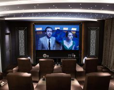 Home Theater Room by Vismara Design with reclining theater seating for luxury villas and high-end spaces