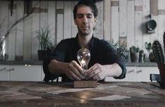 A Desk Lamp With A Levitating Light Bulb