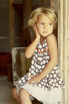 I love this pic! The dress, the blonde curls, the rustic setting … yes, please! #cutekidpic #dotsanddaisies