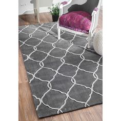 Quality meets value in this beautiful modern area rug. Handmade with polyester to prevent shedding, this plush area rug will enhance any home decor.