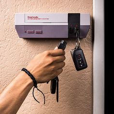 Long live your childhood gaming with the Keytendo Video Game Console Key Holder. This key storage system looks identical to a Nintendo NES. Game Tester Jobs, Video Game Decor, Video Games, Nes Console, Console Storage, Key Storage, Game Storage, Wall Key Holder, Key Rack
