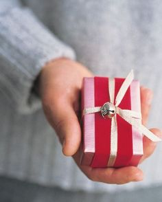 Jingle Bell Topper - Re-create the sound of Santa's sleigh with a small bell attached to Christmas parcels. Purchase the bells at crafts stores, and use lengths of thin ribbon or cord to secure to packages. The box shown here is also decorated with a band of velvet ribbon. #giftwrap #diy