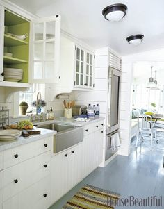 In an all-white kitchen: paint the inside of the cupboard. Love this!