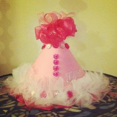 My daughters first birthday hat. Made out of Paper, ribbons, tule, and jewels. Photo by beautybynicole • Instagram