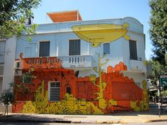 """The creative agency who owns this building recruited Gualicho to make their office a little more memorable. Links to a """"street tour"""" by Graffiti Mundo in Buenos Aires"""