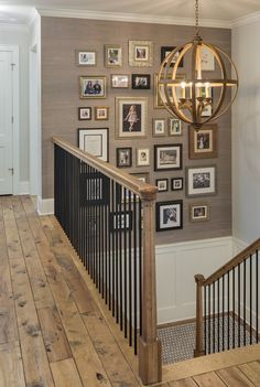 Great Neighborhood Homes - Custom Home Builder | Edina Spring Showcase Home 2015 Stair Gallery Wall, Stairway Photo Gallery, Stairway Picture Wall, Stairway Photos, Stairway Art, Travel Gallery Wall, Stairway Lighting, Gallery Wall Frames, Foyer Lighting