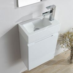 Wall hung bathroom basin sink cabinet vanity unit with a professional high gloss finish. Cloakroom Vanity Unit, Cloakroom Suites, Vanity Units, Close Coupled Toilets, Basin Sink Bathroom, Wall Hung Vanity, Storage Spaces, The Unit, Elsa