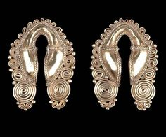 Indonesia ~ Small Sunda Island ~ Nusa Tenggara Timur province | Pair of gold earrings from Sumba Island | 19th to 20th century | These types of earrings were likely to be part of a woman's bridal gifts.